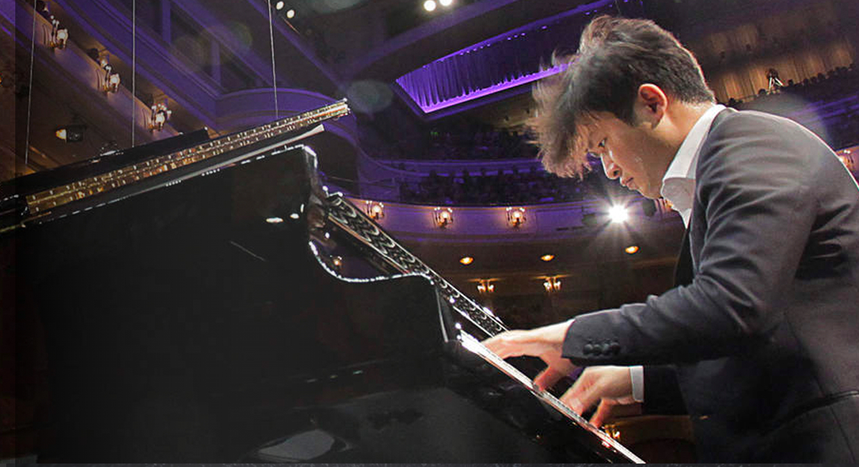 Man playing concert piano