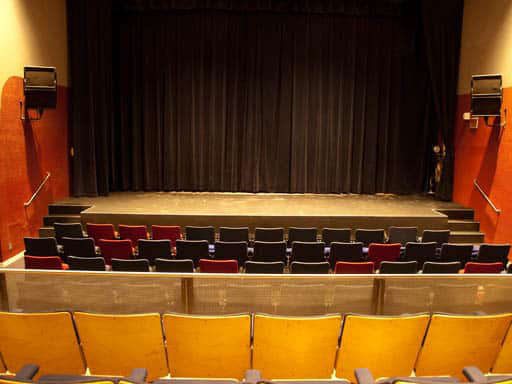 empty theatre seats and stage