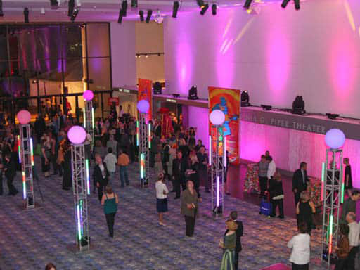 people in event lobby with colored lights