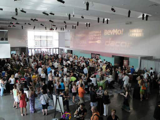people gathered in a large open lobby