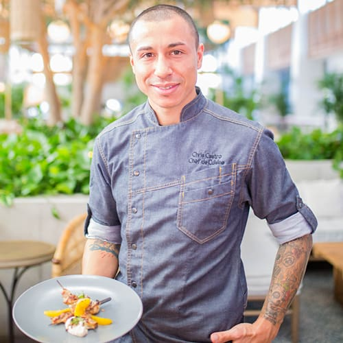 A chef and a plate of food