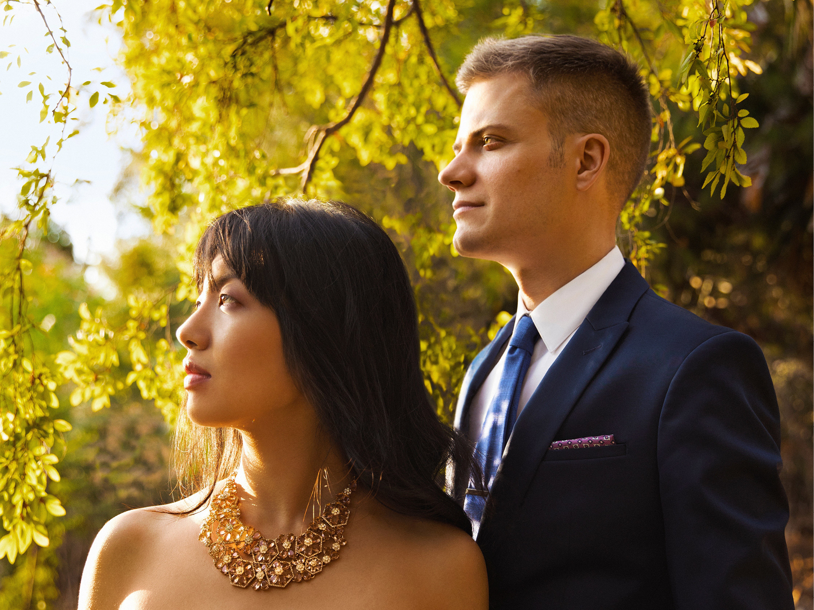A man and a women looking off into the distance