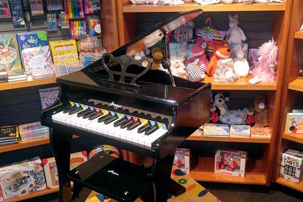 A mini piano inside of a store