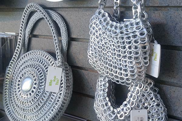 Purses made of can tabs at an art fair